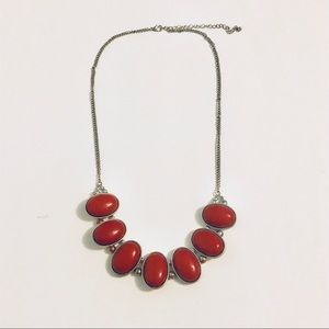 Red statement bib necklace